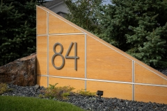 """Residential House Numbers   Material: 3/8"""" aluminum   Finish: Brushed Aluminum   Font: TimeBurner   Size: Custom   Substrate: Custom wood wall"""