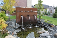one three three on corten with waterfall