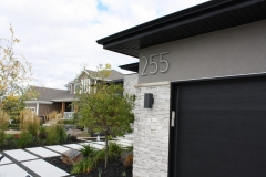 """Residential House Numbers   Material: 3/8"""" aluminum   Finish: Brushed Aluminum   Font: TimeBurner   Size: 12""""   Substrate: Stucco"""
