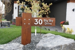 """Residential House Numbers   Material: 3/8"""" aluminum   Finish: Brushed Aluminum   Font: Custom   Size: Various   Substrate: Wood sign"""