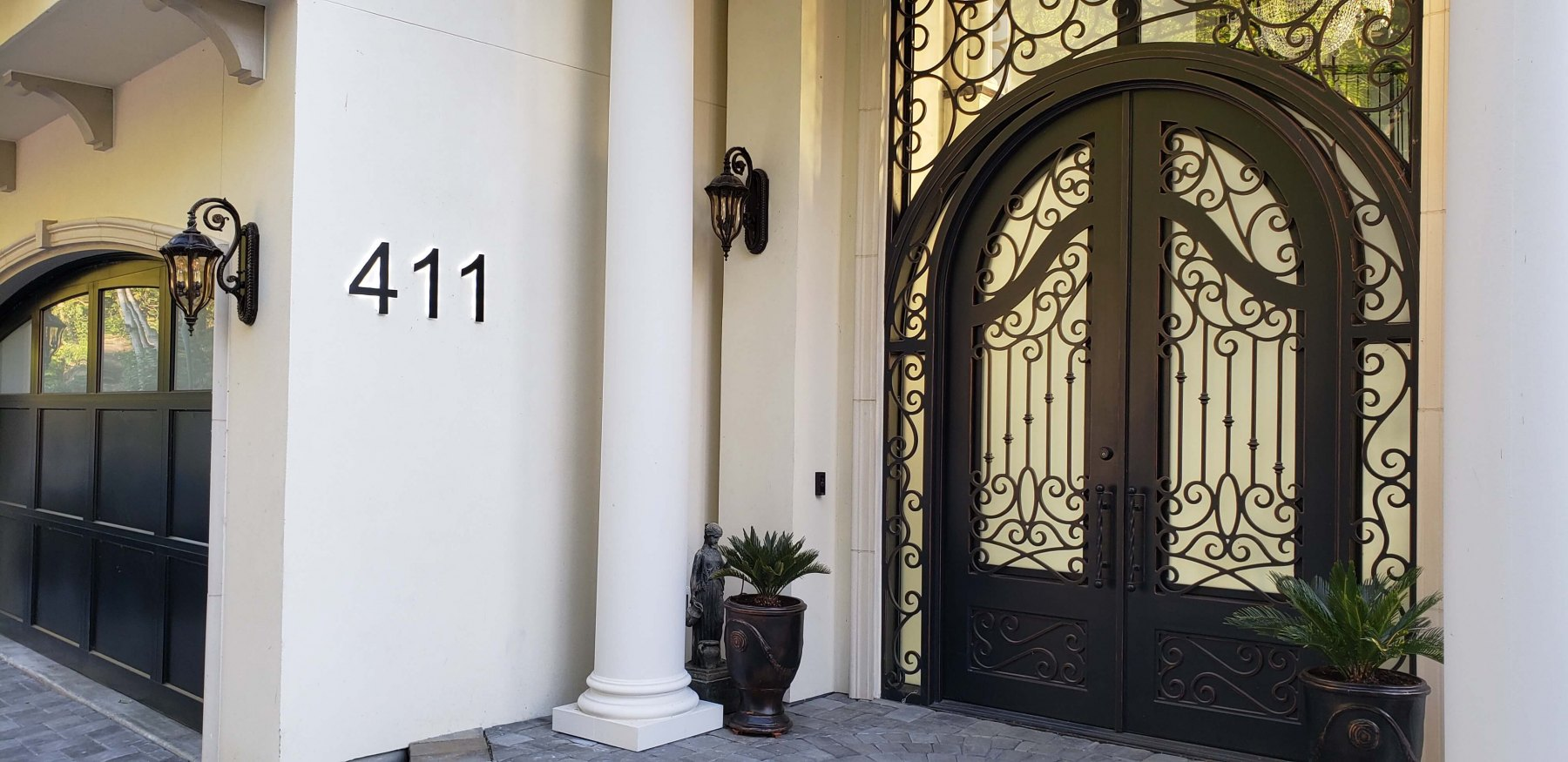 Vivid House Number | Residential House Sign | Number 411 | Black Finish | LED Backlight | Whitewall in front of a house