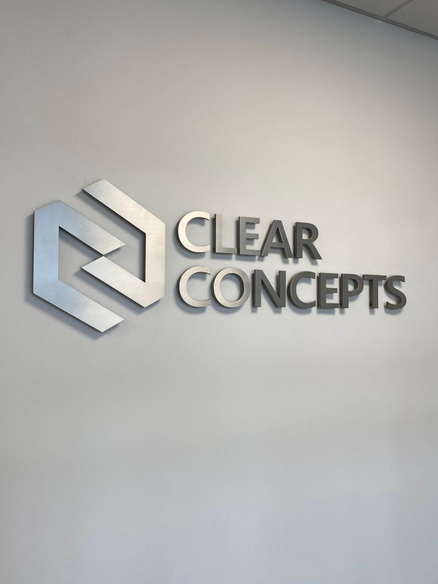Vivid House Numbers | Custom Commercial Sign | Clear Concepts | Brushed Aluminum Finish on a grey wall