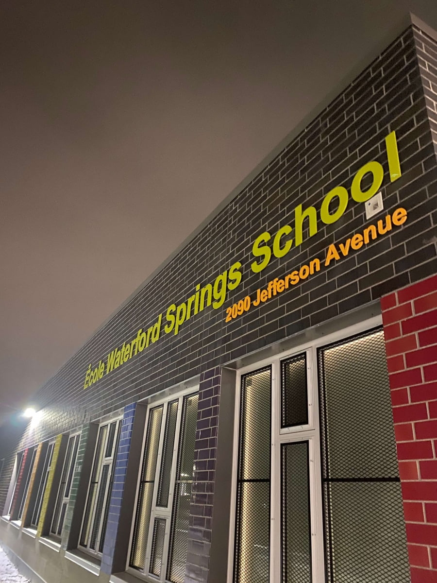 Vivid House Number | Custom Commercial Sign | Ecole Waterford Springs School 2090 Jefferson Avenue | Brushed Green and Orange Finish | Brick Wall