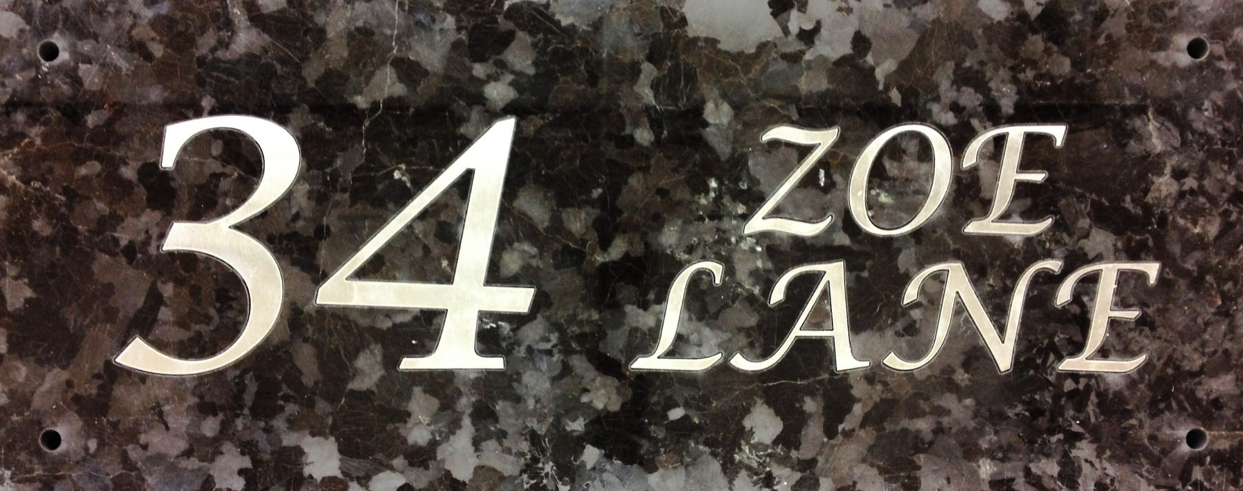 Vivid House Number | Custom Residential House Signs| 34 Zoe Lane | Brushed Aluminum Finish on a granite material