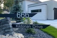 Vivid House Number | Residential House Sign | 666 Kildonan Drive | Brushed Aluminum Finish | Custom Black Sign on a Lawn