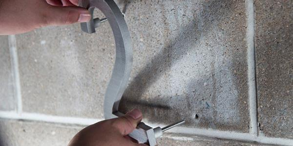 House numbers installation - Step 5: Place all-weather silicone or epoxy in the wall holes that were drilled in step 2.